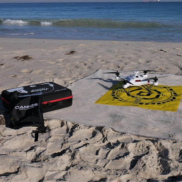 OANNES Beach fishing with a drone Landing Mat Design